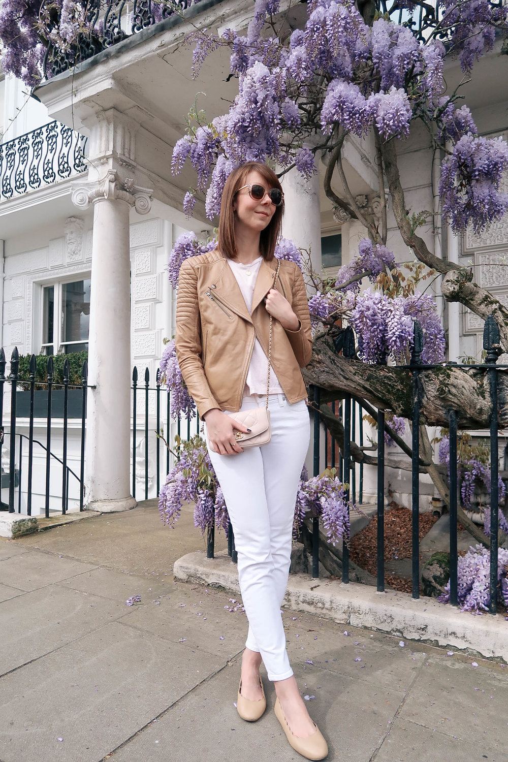 Purple wisteria blossoms in Notting Hill, London wearing J.Crew jeans and a Chanel quilted bag | Pink, Purple and Petals | Sundays and Somedays