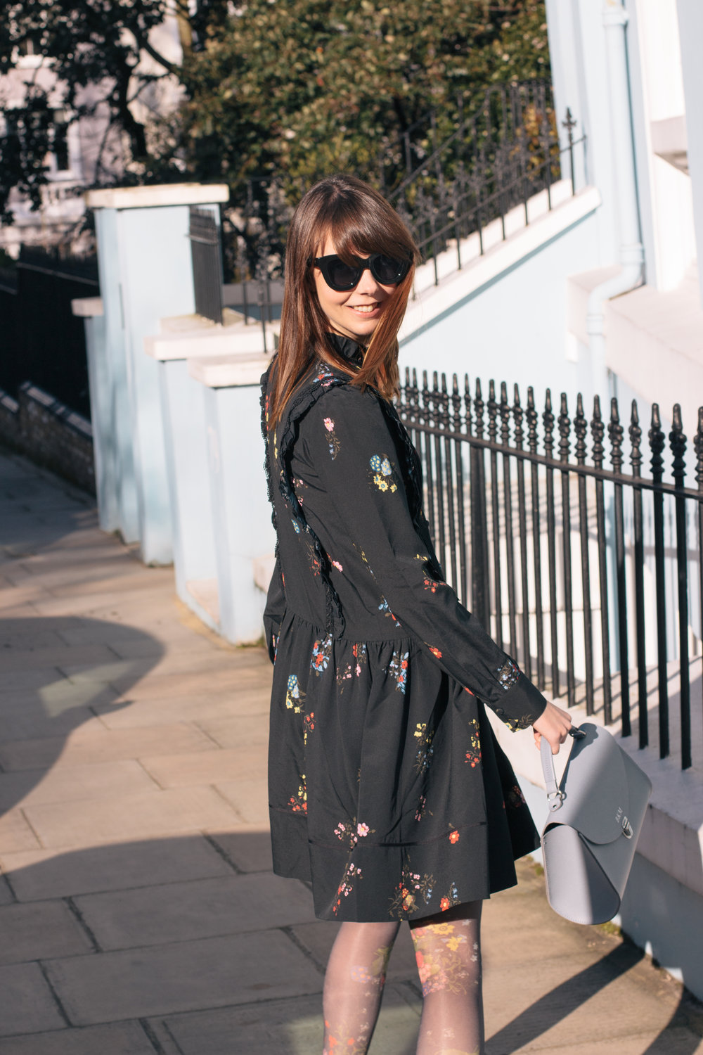 Is It Spring Yet? | Wearing Spring on my sleeve in and Erdem x H&M dress, a Poppy bag from Cambridge Satchel Company and velvet flats from Boden while wandering around looking at blooms and colorful houses in Notting Hill, West London | Sundays and Somedays