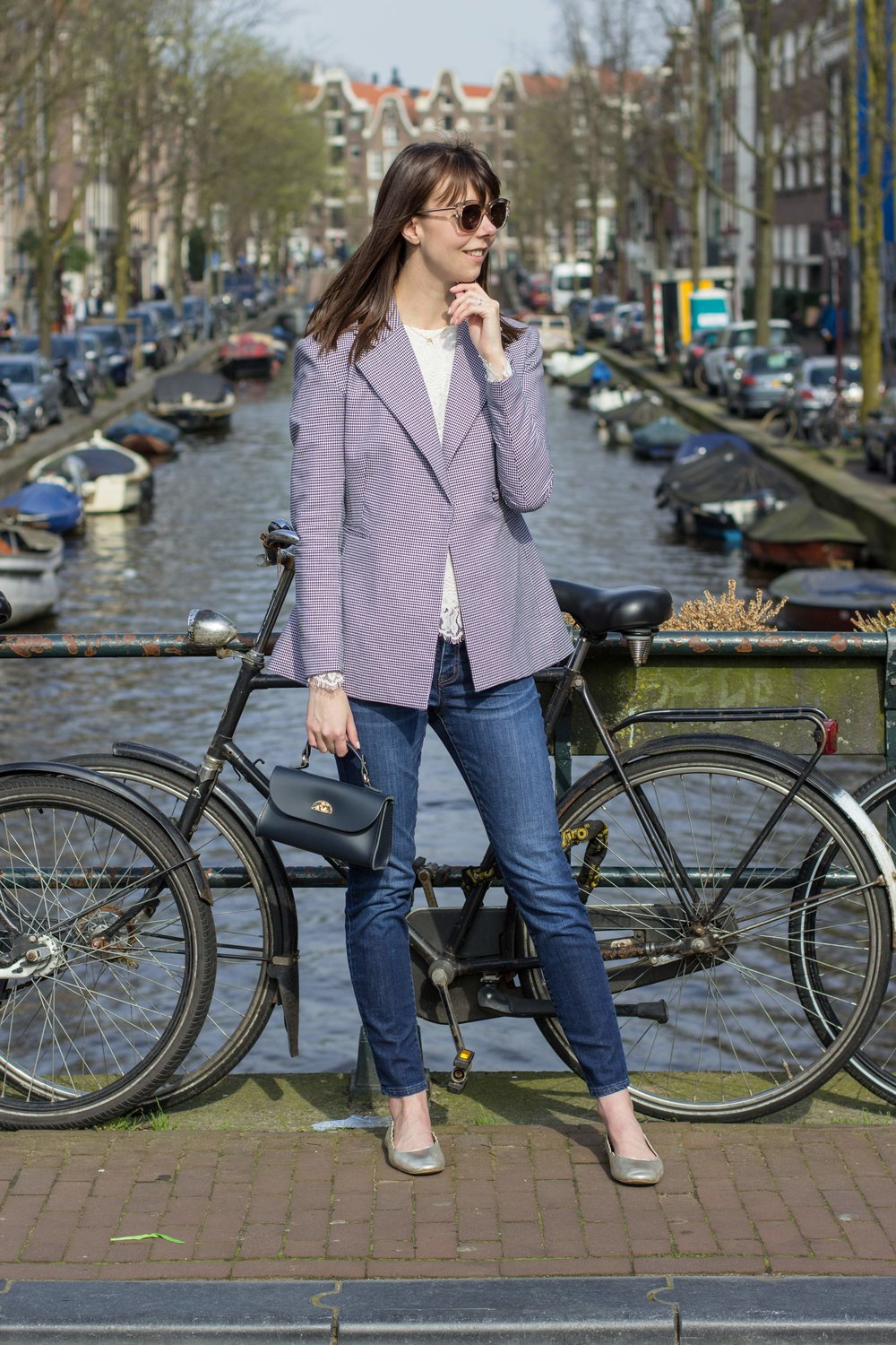 Wearing the checked blue and white blazer for spring over a lace top, delicate accessories and a Cambridge Satchel Company Daisy bag for spring in Amsterdam.
