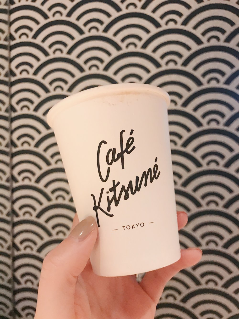 Café Kitsuné - Café Kitsuné makes my favorite hot chocolate in Paris, so I knew I needed to try out their Tokyo outpost. I was expecting a cookie cutter version of their French location, but was pleasantly surprised to find the interiors taking cues from Japanese design, from the wooden details to the wallpaper. And yep, the hot chocolate is just as good—so good that I forgot to take a photo before I finished it, so here's me, holding an empty cup!3 Chome-17-1 Minamiaoyama, Minato City, Tokyo 107-0062, Japan