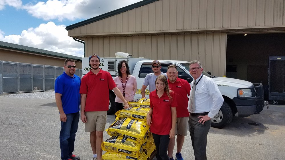 members of the wud team delivering food to Walton county animal shelter