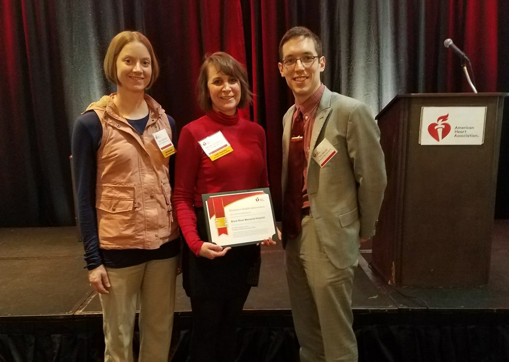 Dawn Jacobson and Nicole Schweitzer of Black River Memorial Hospital Wellness Committee with Tim Nikolai, Wisconsin Heart Association at the Wisconsin Workplace Health Symposium in Brookfield, WI.