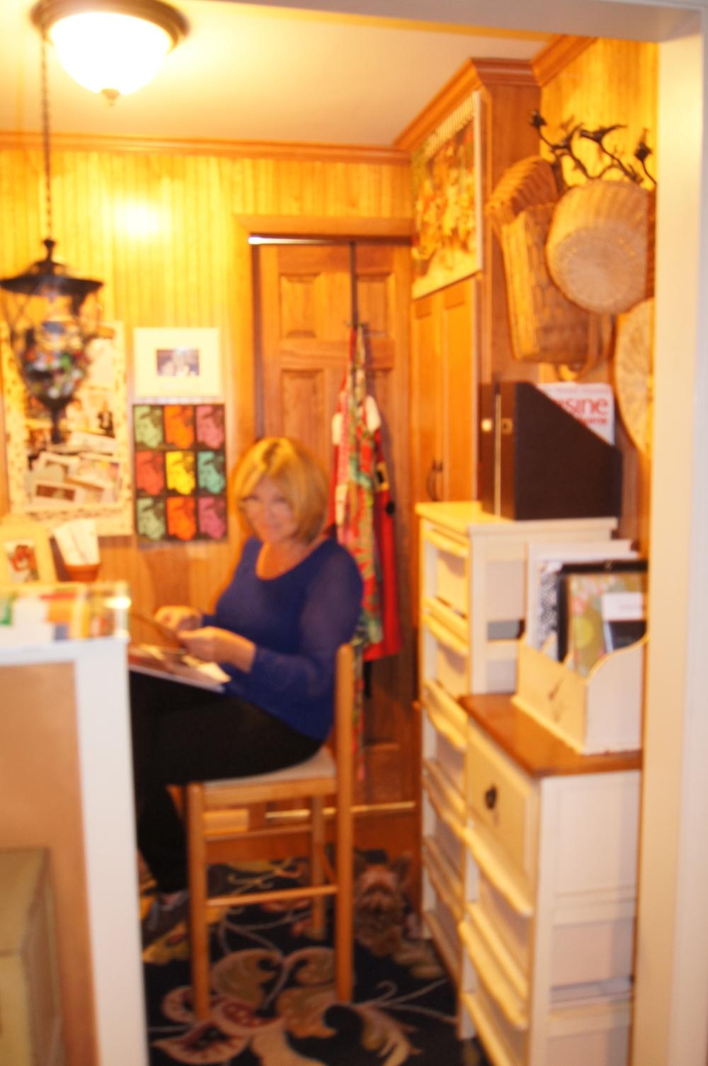 Annalynn, tucked in her little office