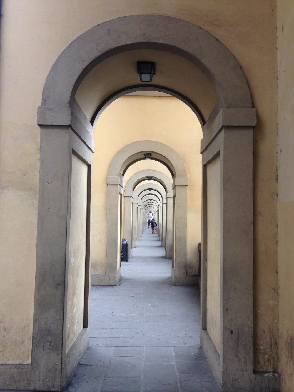 walkway by ponte vecchio, florence, italy