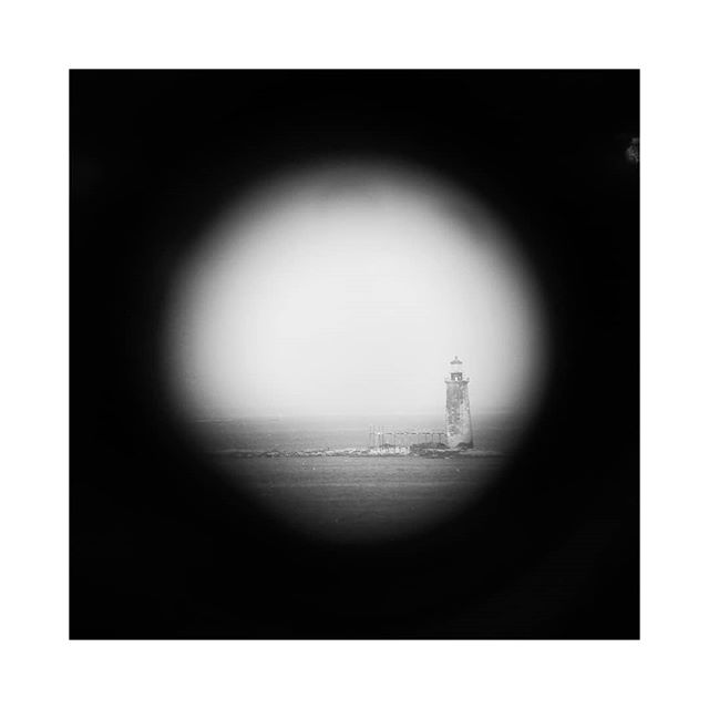 Staring off into Casco Bay. #calendarislands. Shout out to @everything.yas for telling me about the preview app. . . #lookingthrough #lookingthroughbinoculars #blackandwhitephotography #naturalvignette  #peephole  #lighthouse #cascobay #mainetourism  #capeelizabeth  #portlandheadlight  #portlandheadlighthouse  #portlandmaine