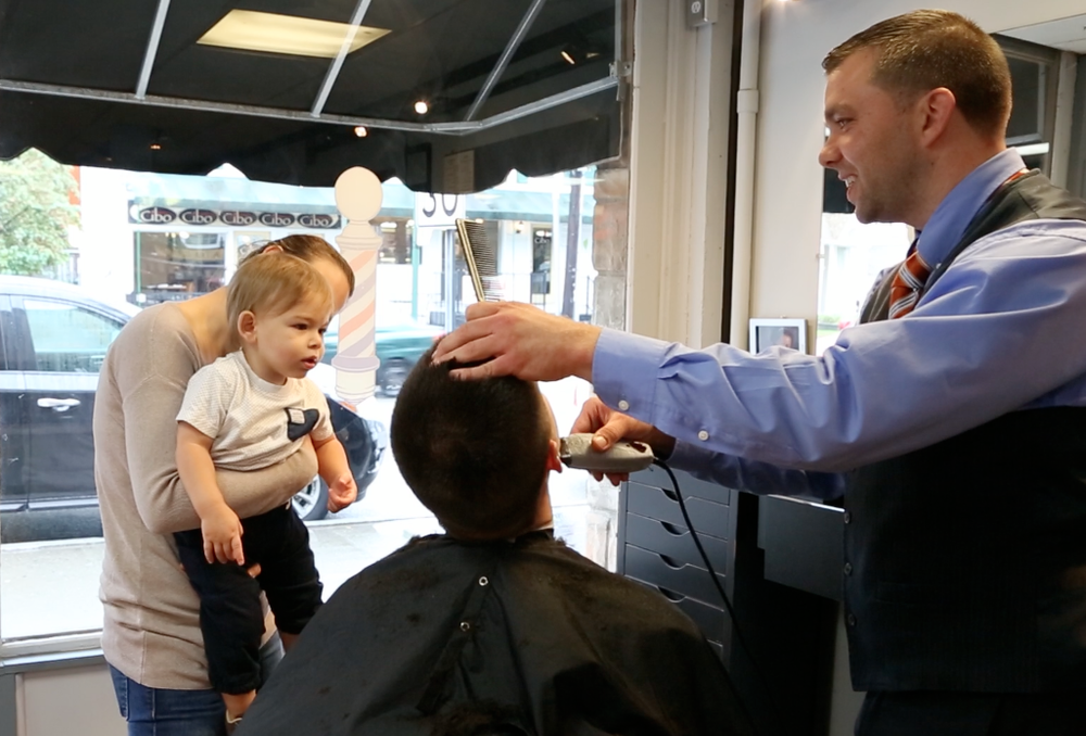 "• Bring your child to the barbershop or hair salon before their first haircut to watch a parent or sibling get a haircut. This gives them a chance to get familiar with the place and the idea of getting a haircut so they'll feel more comfortable when it's their turn.  • Comb your child's hair thoroughly to untangle knots before his or her haircut. Removing knots can be painful and makes it harder for a barber or stylist to gain your child's trust.  • Don't ask your child questions that are likely to trigger a negative response. For example, don't say, ""Do you want a haircut?"" or ""Does it hurt?"""