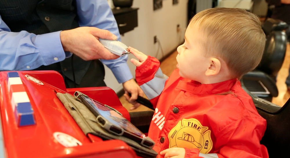 Allow the child to see and touch the clipper or comb. Children are   curious by nature. Showing the clipper or comb to the child helps them   understand what it is, and that it does not hurt.