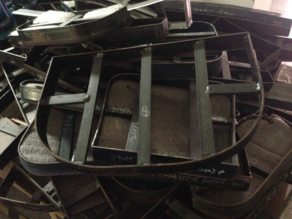 Custom metal mould to cut each piece of material for a rucksack. Chinese textiles factory, Dec 2014