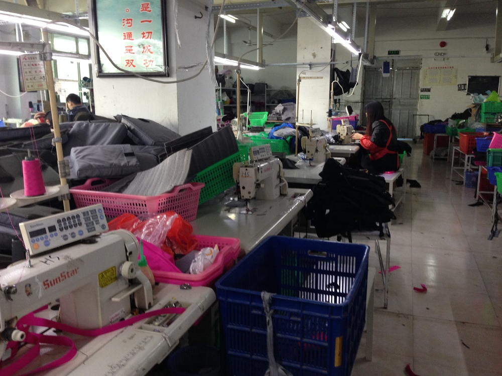 Material, sewing machines, stuff everywhere. A textiles factory in action in China.
