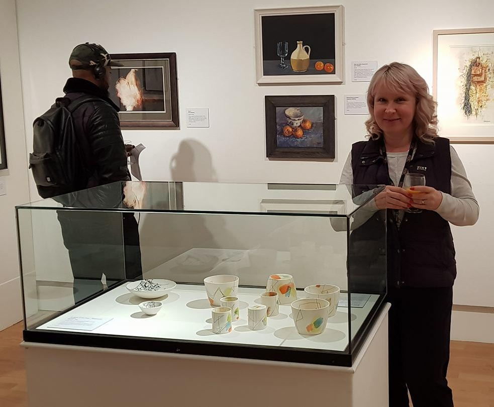 Sue Pitt with her ceramics 1.jpg
