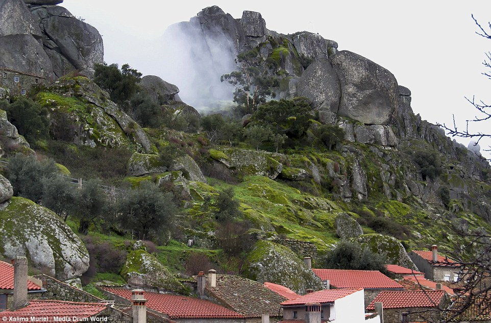 The cliffs surrounding the village are strewn with enormous rocks