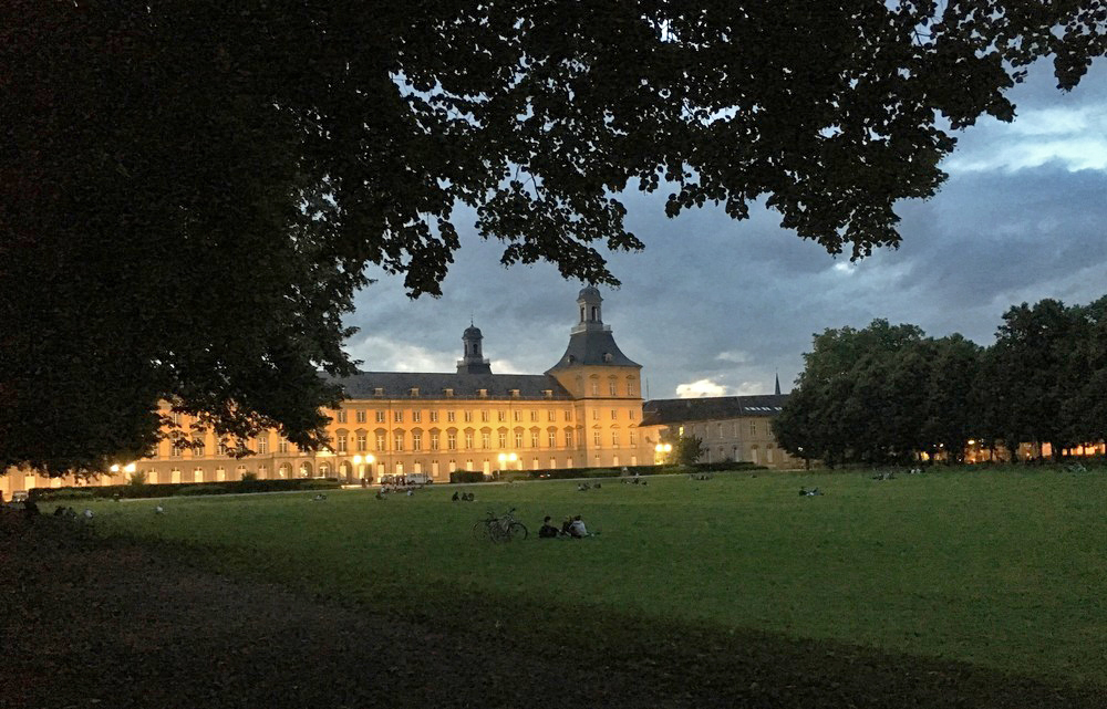 "Public park ""Hofgarten"" with the University of Bonn in the background."