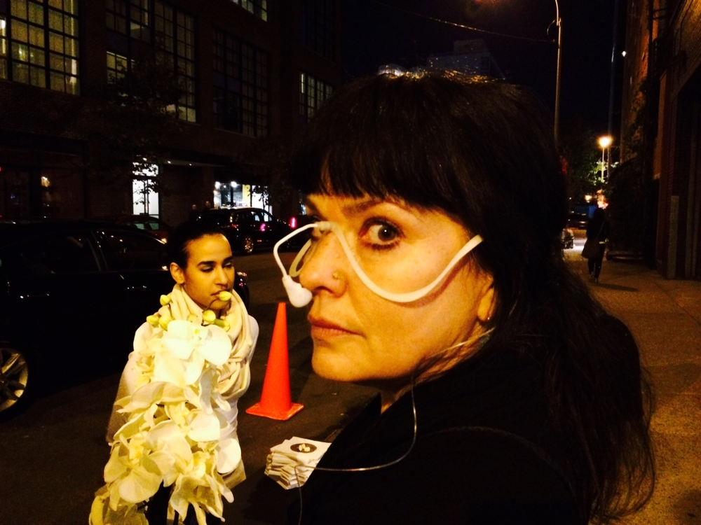 Karina Cousineau of Karina Dresses looking very chic while experiencing non-food. And how about that great idea for a Halloween costume in the background.