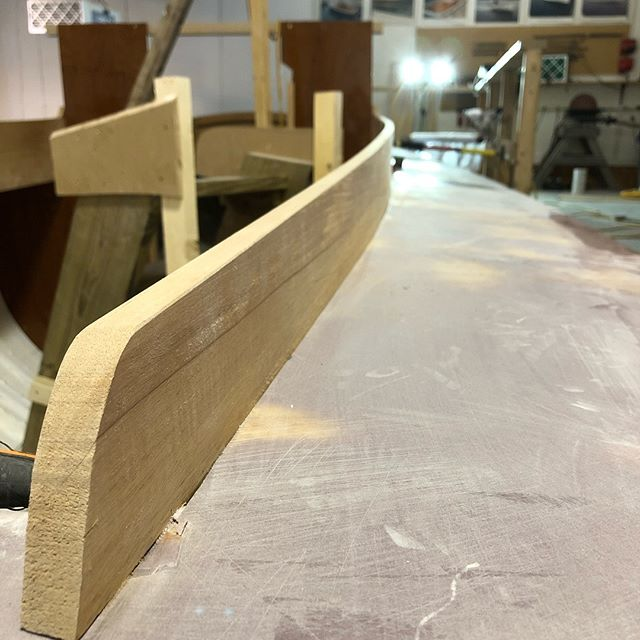 After a few days of board sanding we now have the decks 95% fair. That's enough to get the combings in and glued. It is a sharp bend, but luckily on this boat they are fairly thin and took to it well. We added more camber to the front end to give it a little more Downeast style than its original as well. #internationalonedesign #northeastharborfleet #northeastharbormaine #greatharbor #sailboat #sailboatracing