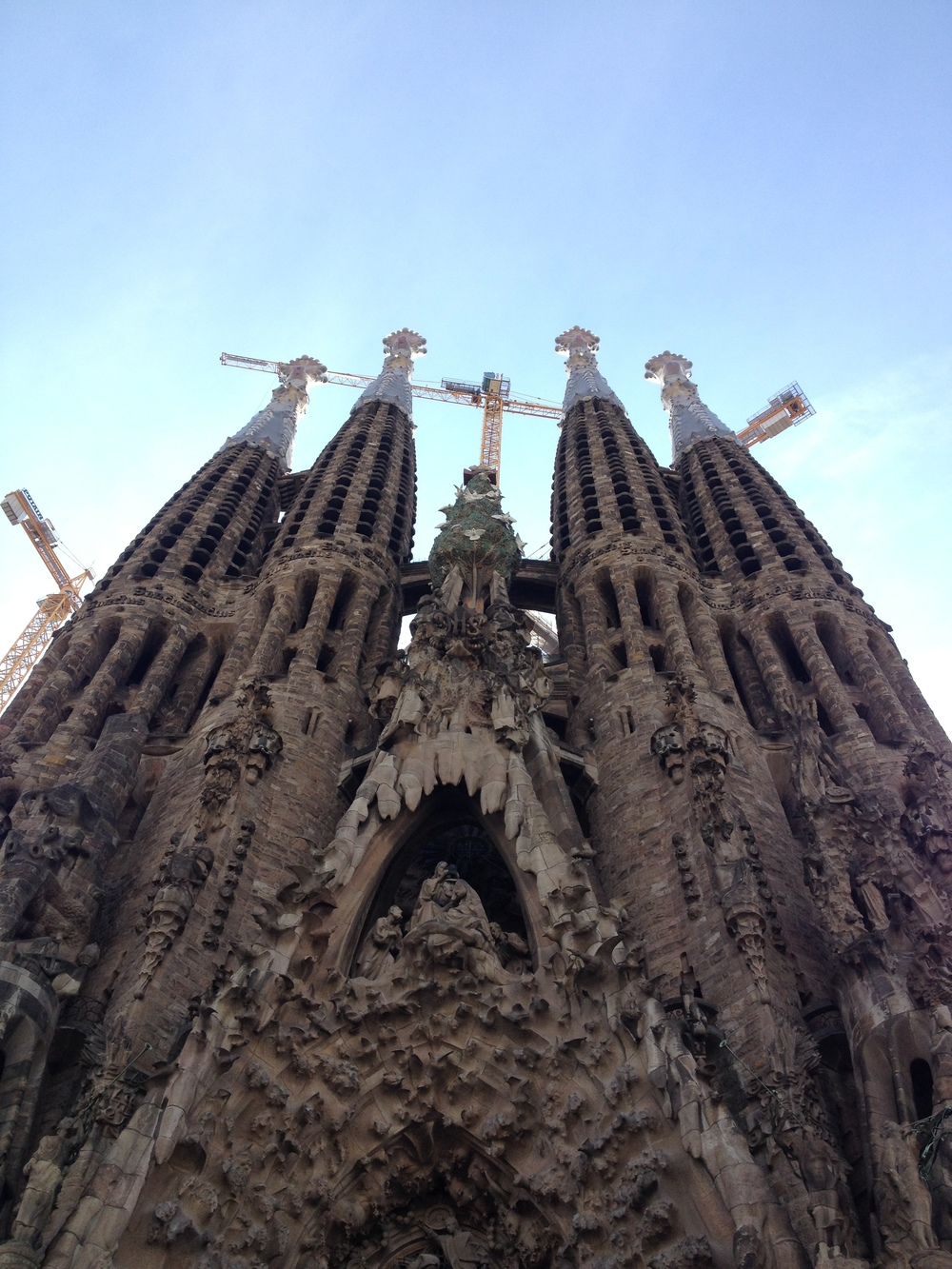 The Sagrada Familia haunts Barcelona from above, it's dripping presence being built slowly for years.