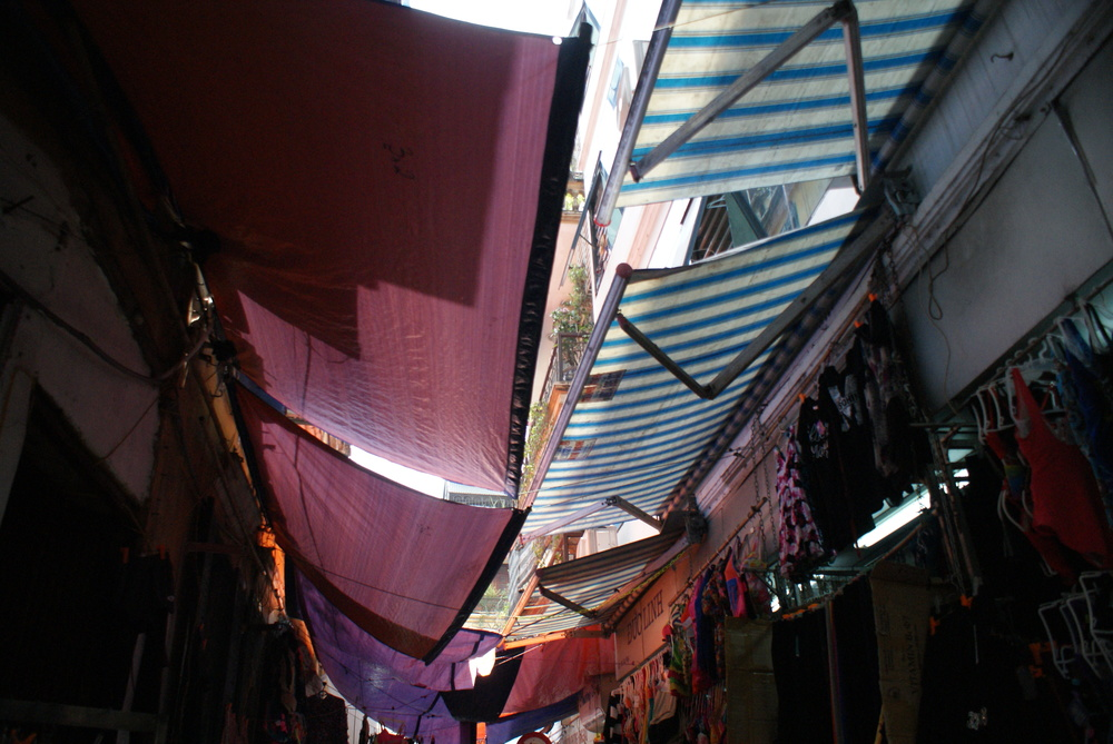 Cloth awnings keep street dwellers away from the hot sun.