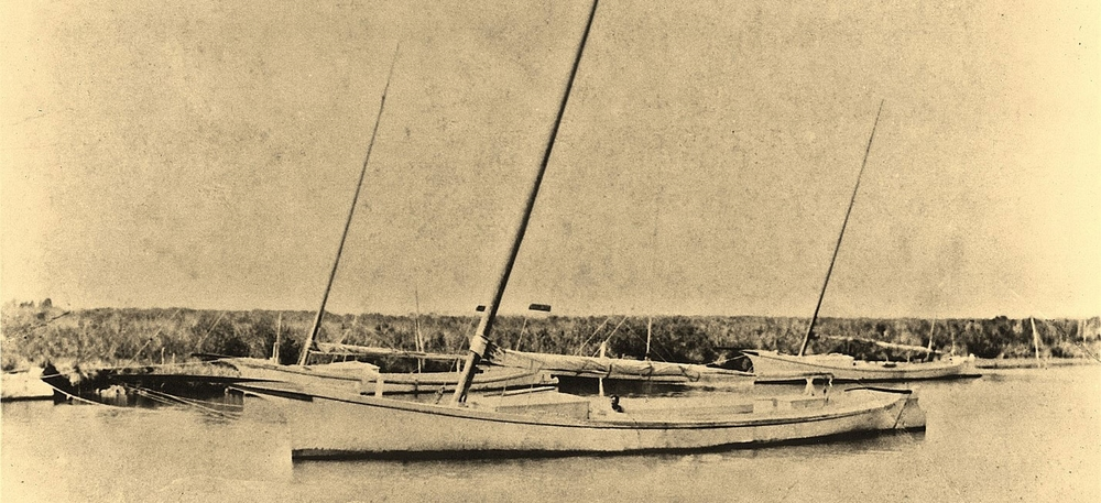 This is actually the Louise Temple, one of five boats built by Horace Bundick. Louise was built after Annie and was a little shorter. We think the boat in the background to the stern of the Louise Temple is Annie. Annie and Bundick's other canoes were unique as there was not a lot of canoe building on the Eastern Shore of Virginia. The primary log canoe building centers were Poquoson, Pocomoke Sound, and Tilghman's Island. This picture was used for the restoration details. We are very lucky to have a lot of documentation that was researched and compiled by Dr.  Harry Holcomb. Annie is probably the largest log canoe still in existence. She was used oystering, fishing, crabbing, and hauling produce. She had a long career and was on the water from 1904 till 1978.