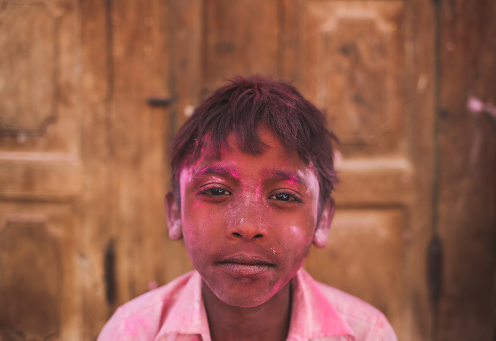 Vrindavan, India - March 23rd, 2016: Portrait of a young boy on the day before Holi.