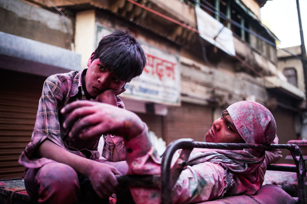 Mathura, India - March 24  th, 2016:  Two young boys take a break after a long day of Holi celebrations.