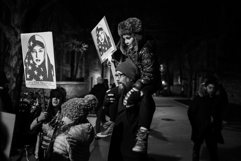New Haven, Connecticut - January 29th, 2017: A vigil is held for immigrants and refugees following president Trump's executive order to ban specific countries from entering the United States of America.