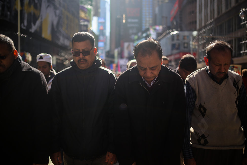 Men share afternoon prayer in Times Square during the I Am A Muslim Too rally // February 19th, 2017 // New York City.