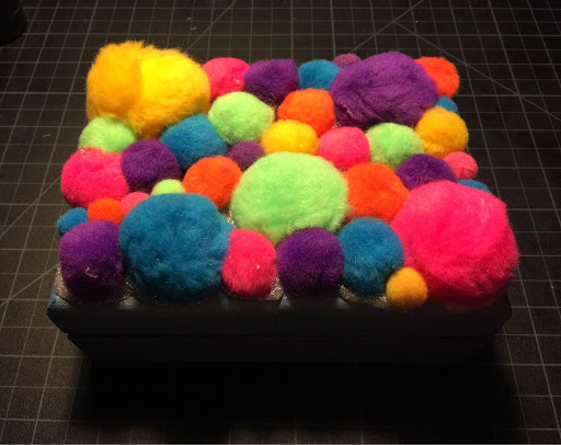 Rainbow pom poms make me happy.
