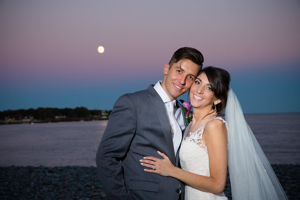 bride and groom with harvest moon in background