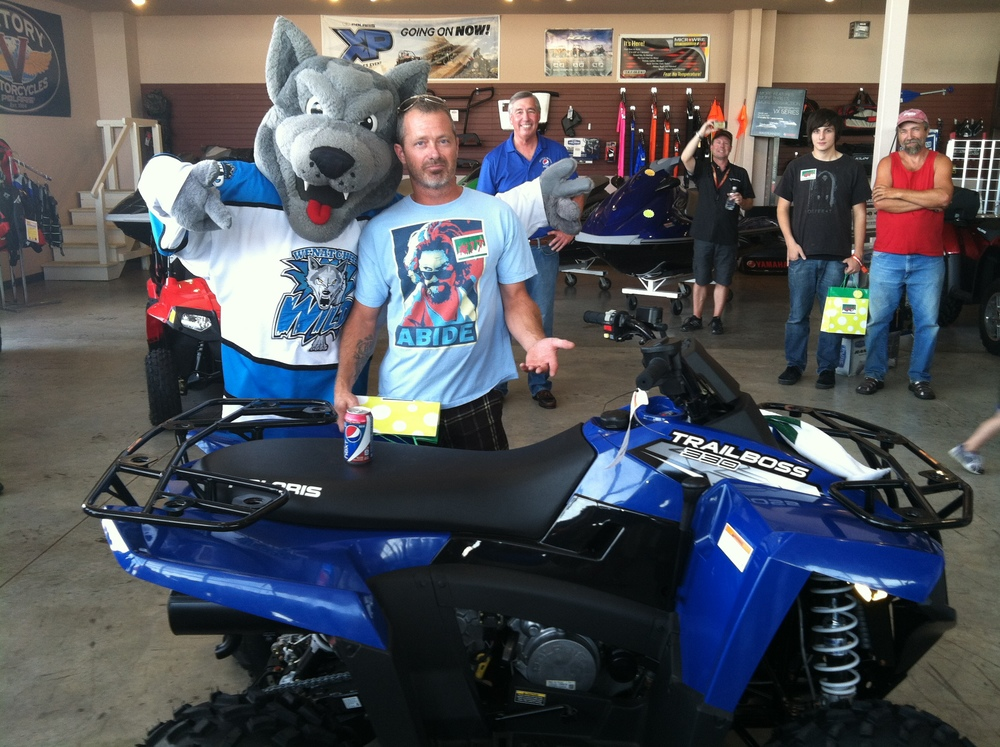 Weinstein Beverage's support of the Town Toyota Center in Wenatchee (featuring Walt the Wolf - mascot of the Wenatchee Wild)).