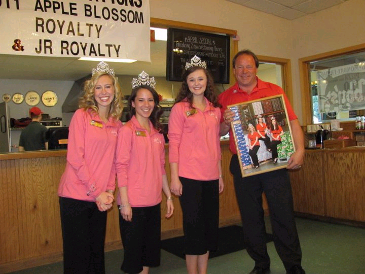 Apple Blossom Festival Royalty presenting Weinstein with their annual appreciation photo in recognition of our local company's contributions..