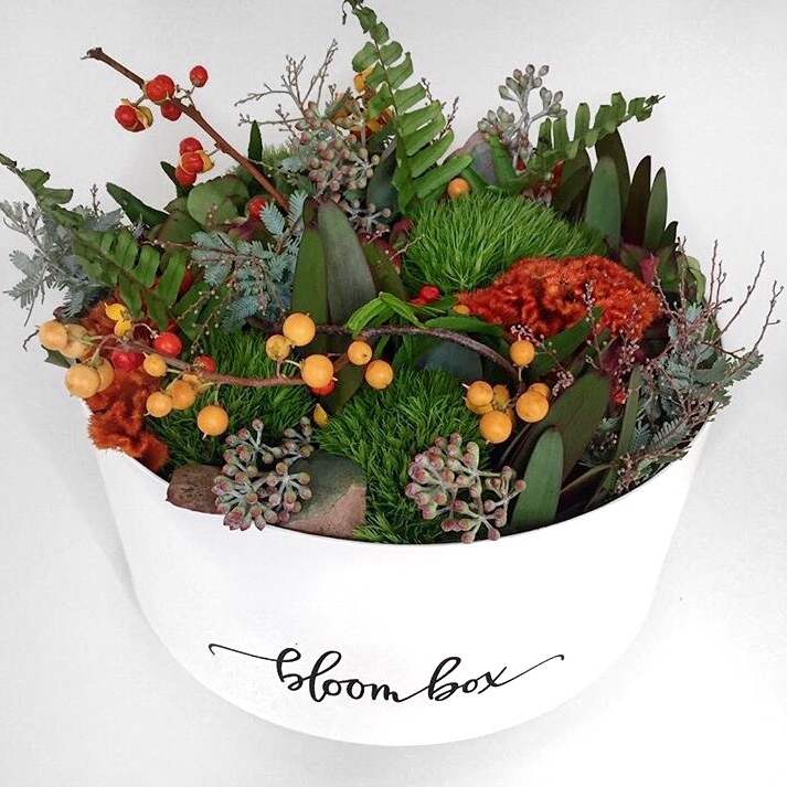 """An all textural """"apology"""" bloom box ordered by one of our clients for his girlfriend featuring bittersweet berries, orange celosia, green trick, seeded eucalyptus, and leucadendron. Photo taken from @amyanne_ on Instagram."""
