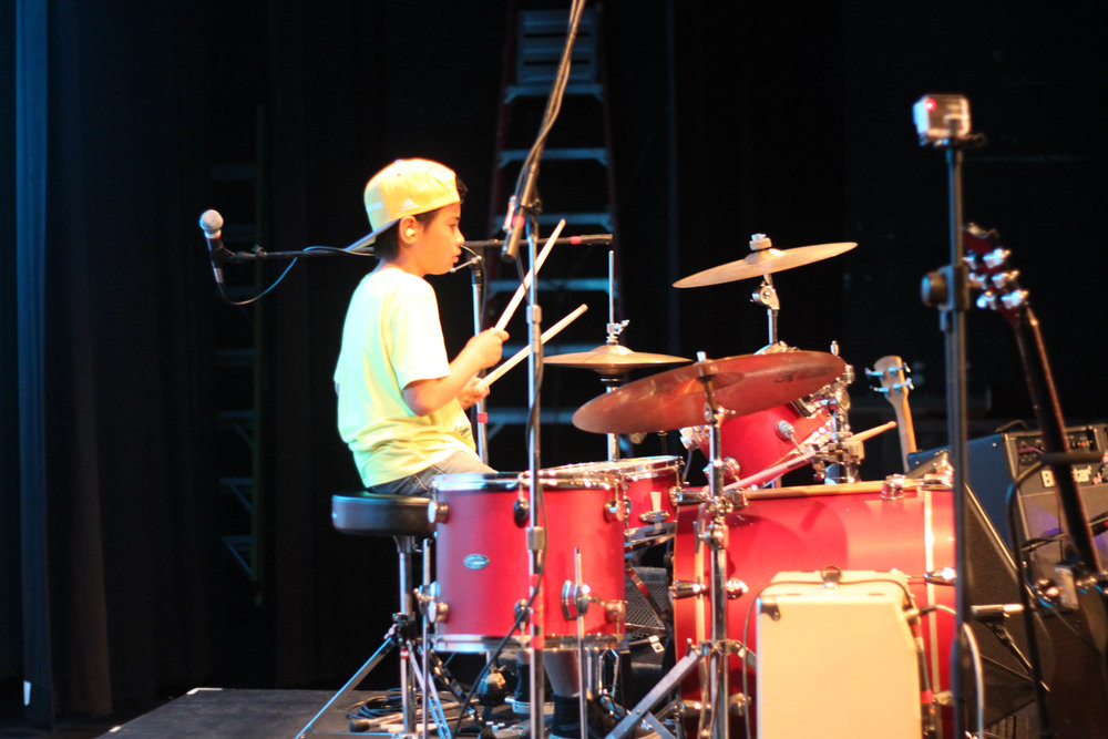Isaak on drums