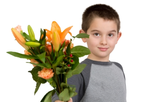 Boy gives flowers