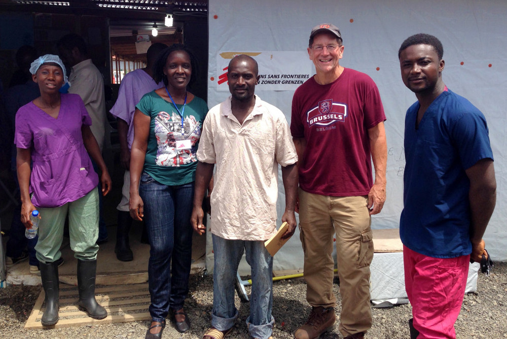 Staff and some survivors pose with Dr. Daniel Lucey in Monrovia, Liberia as he and local health teams battled against last year's Ebola crisis.