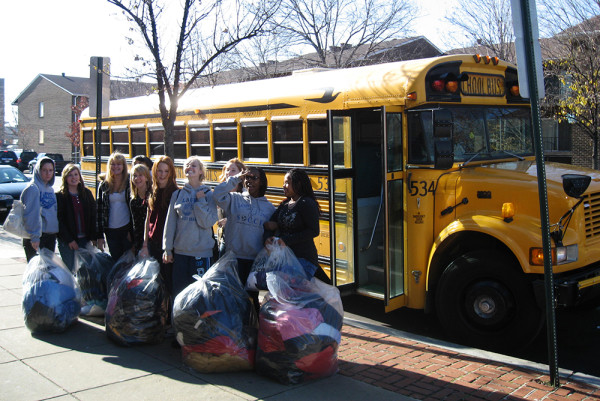 Community members carry bags filled with donations for the clothing program, located at the Southeast D.C. location.