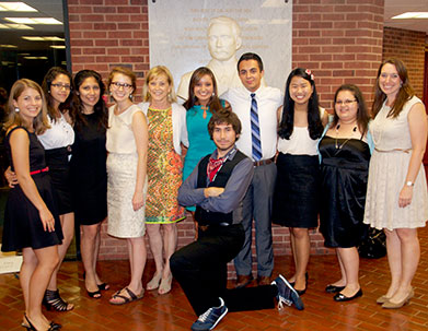 Jane Genster, fifth from left, now president and CEO of the Cristo Rey Network, poses with Georgetown student mentors of Cristo Rey and KIPP students participating in the 2013 Summer Immersion program. Program director Kyle Burns is pictured far right, with assistant director Katie Suter far left.