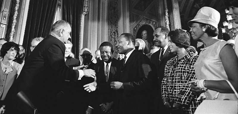 President Lyndon B. Johnson and Rev. Martin Luther King Jr. shake hands after the signing of the 1965 Voting Rights Act.