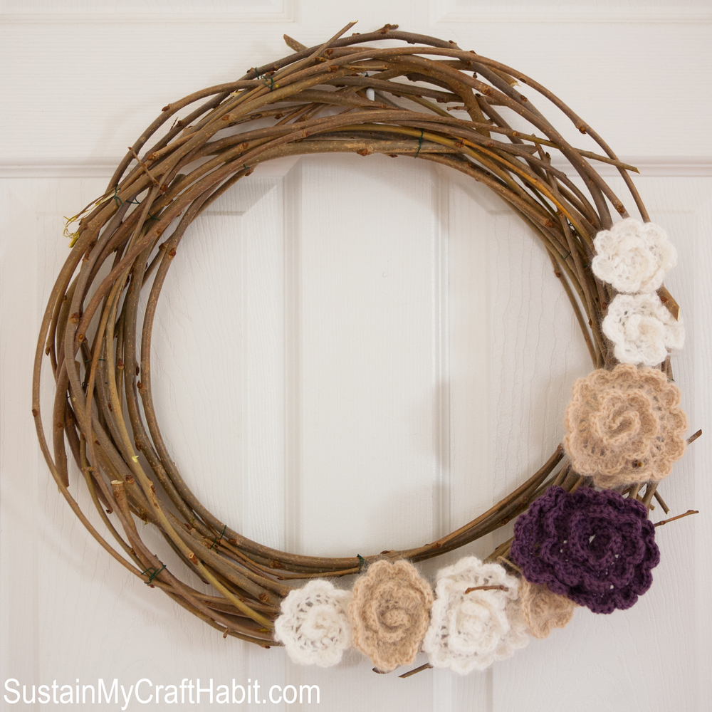 Make you own DIY round wreath with branches clipped from an ornamental mulberry tree. Add quick and easy crochet flowers of various sizes and spring colors for a beautiful home decor idea. Step-by-step tutorial is included!