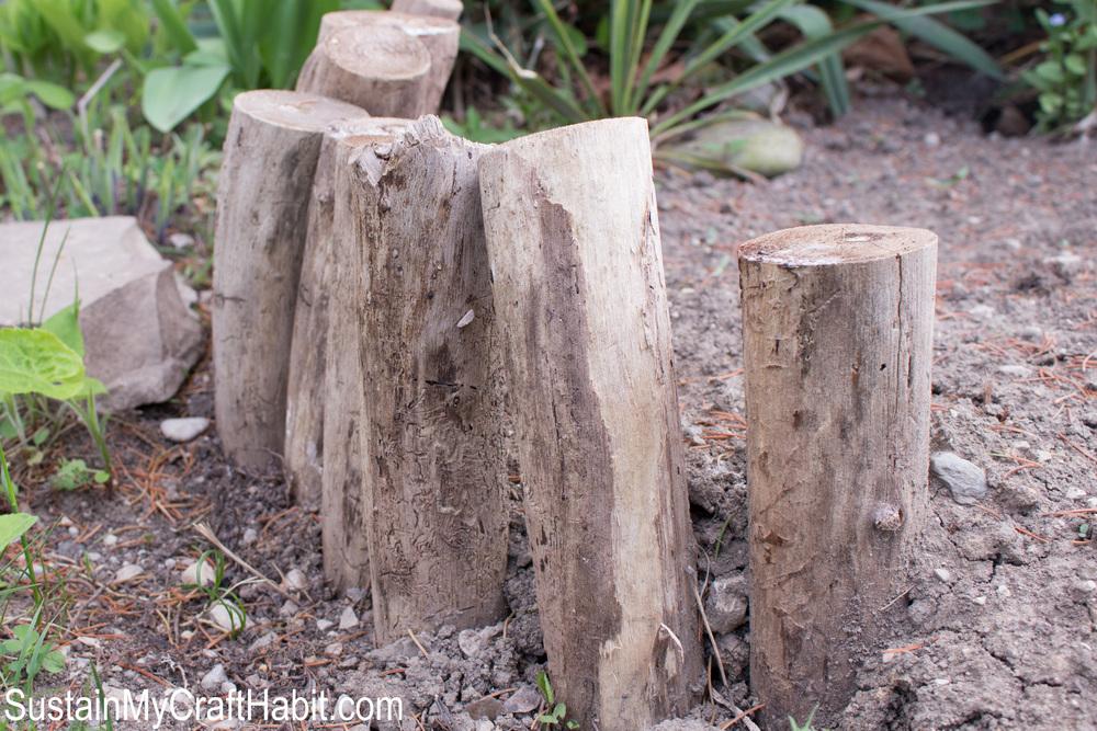 Mini wood post garden barrier