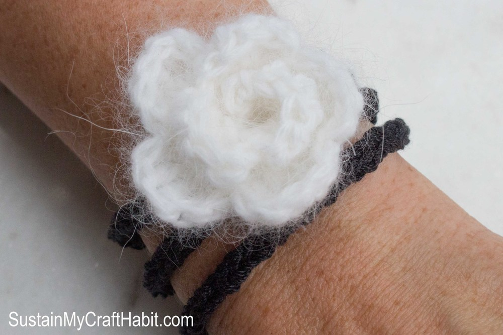 DIY crochet flower and knit cord wrist-wrapped bracelet- SustainMyCraftHabit.com