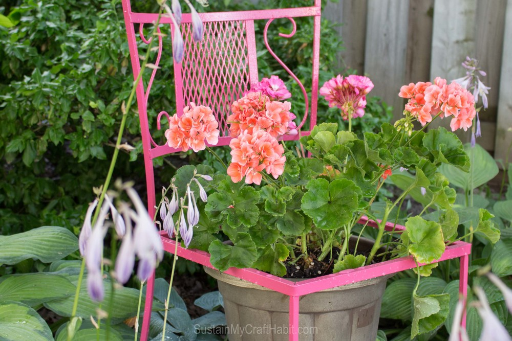 "Transforming Trash: Upcycled ""Wildfire"" Patio Chair Planters. Check out the transformation and repurposing of old moldy patio chairs found on the curb to make a bright and functional planter for the backyard. Click through for the ""before"" pics and full tutorial."