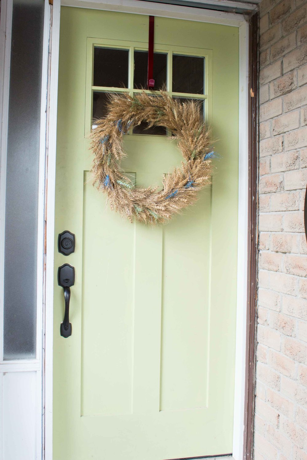 Fall wreath with green and blue paint and glitter - SustainMyCraftHabit.com