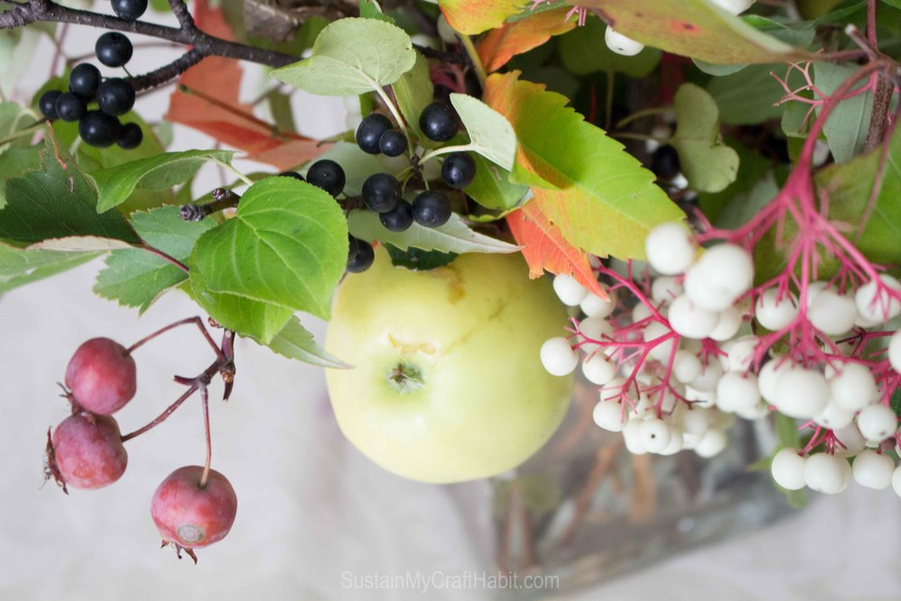 Make a beautiful rustic fall bouquet centerpiece using berries and branches foraged from outdoors.