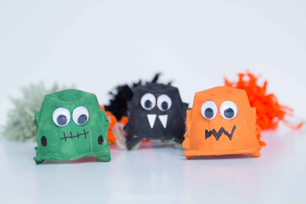 Create a silly garland for Halloween with egg cartons, paint and googly eyes - SustainMyCraftHabit