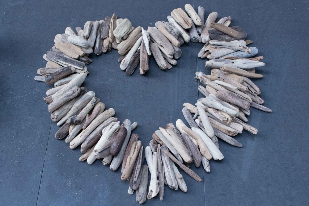 Making a bird from a piece of driftwood. A bright and fun embellishment for a wreath or other holiday decor - SustainMyCraftHabit