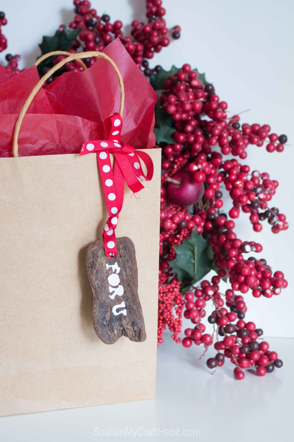 Up your gift-giving game with a natural and rustic DIY stenciled driftwood bark gift tag @SustMyCraft
