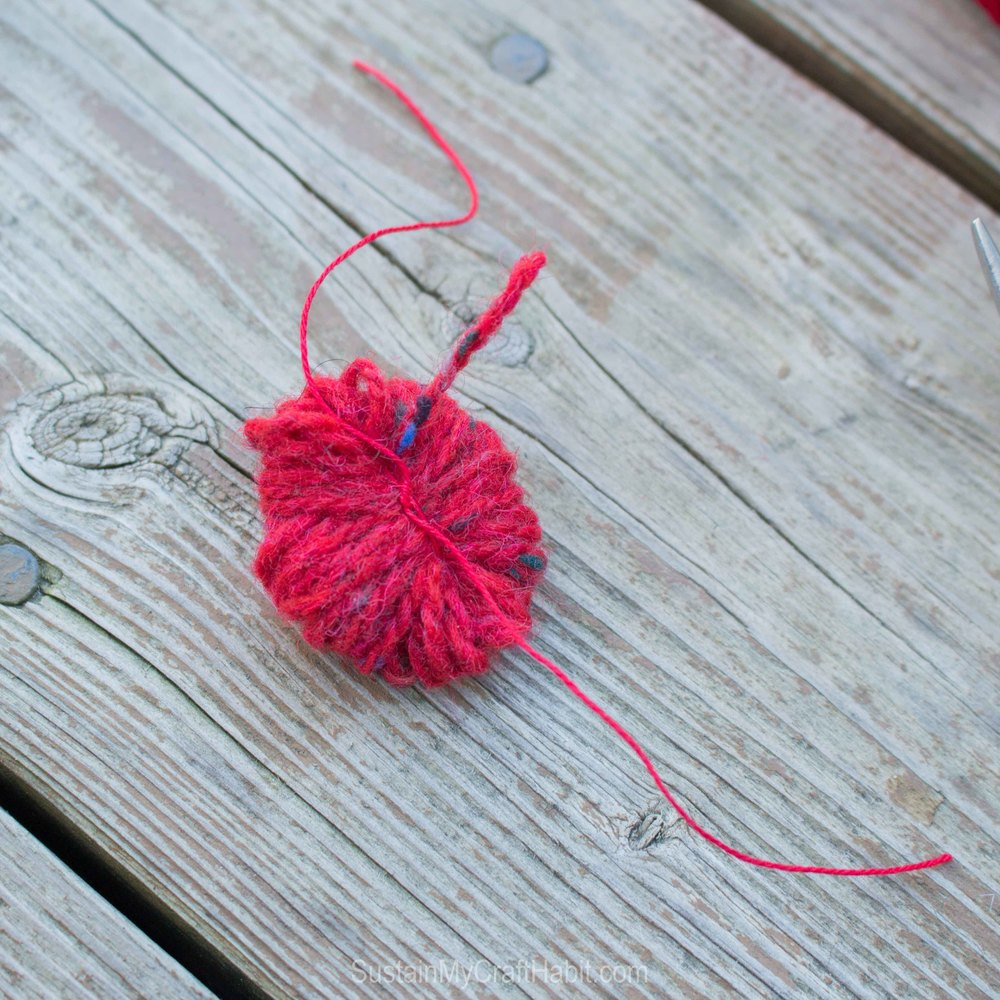 DIY red scrap yarn pom pom garland - SustainMyCraftHabit - SustainMyCraftHabit -2261.jpg