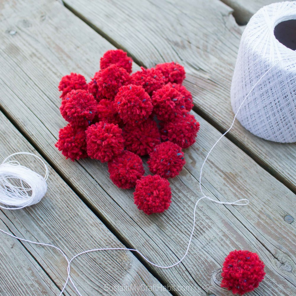 DIY red scrap yarn pom pom garland - SustainMyCraftHabit - SustainMyCraftHabit -2268.jpg