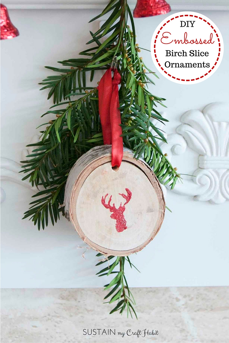 Heat emboss red glitter onto natural birch tree branch slices for a beautiful rustic Christmas ornament.