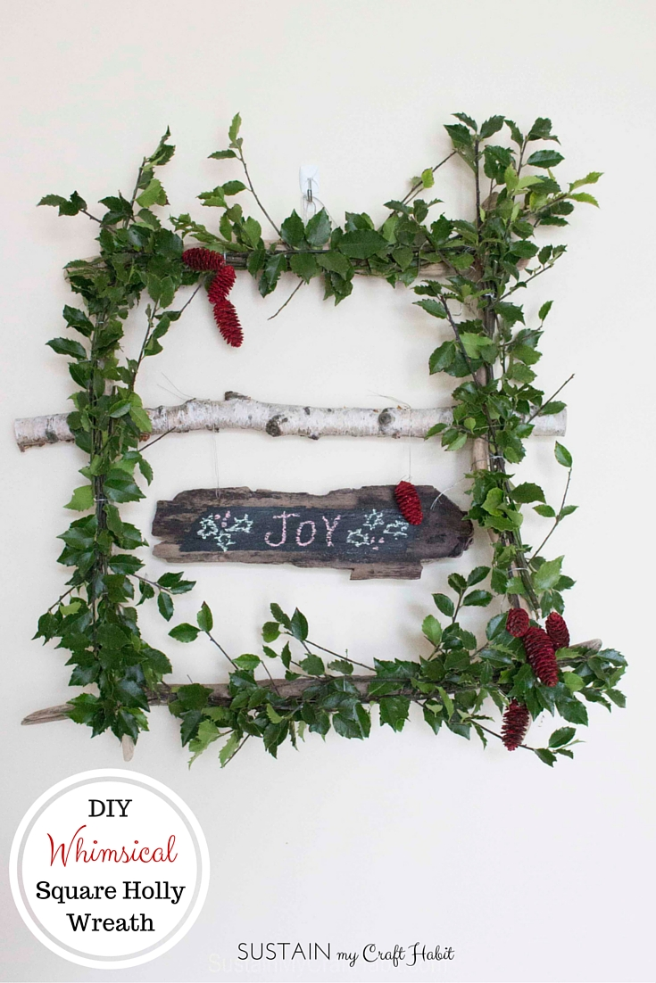 Make a whimsical and wispy square wreath with holly branches. A fun DIY project for the winter or spring. Click through for the full tutorial.
