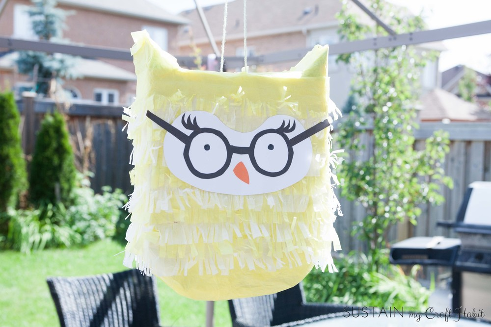 How to make an awesome owl birthday party pinata from a cereal box. These DIY pinatas are great for a boy's or girl's birthday party, baby shower, graduation party or any woodland-themed event. Click through for the full tutorial.